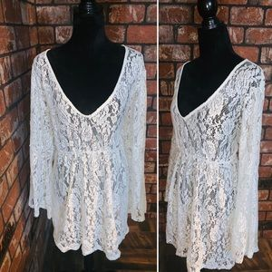 Lace cover up with elastic waist.
